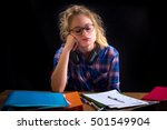 Small photo of a young high school girl who encounter difficulties on homework