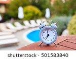 alarm clock near a pool | Shutterstock . vector #501583840