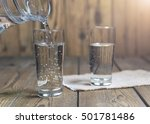 glass of water on a wooden... | Shutterstock . vector #501781486