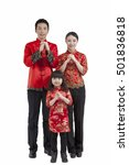 Small photo of Portrait of daughter with parents in Tang suits paying New Year cal