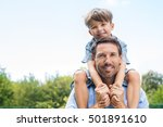happy father giving shoulder... | Shutterstock . vector #501891610