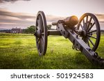 Cannon And Distant Barn