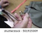 tailor hand's close up holding... | Shutterstock . vector #501925309