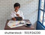 young businessmen sit across... | Shutterstock . vector #501926230