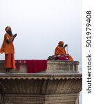 Small photo of Vrindavan - March 1, 2013: Local babaji meditates, at the period after Gaura Purnima festival