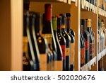Wine Bottles On Wooden Shelf In ...