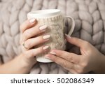 beautiful woman's hands with a... | Shutterstock . vector #502086349