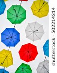 colorful umbrellas background | Shutterstock . vector #502214314