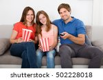 family watching tv with popcorn | Shutterstock . vector #502228018