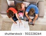 family saving money | Shutterstock . vector #502228264