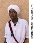 Small photo of MERZOUGA, MOROCCO - OCTOBER 10, 2016: Portrait of unidentified man from Gnawa tribe or Bambaras, who originate from Subsaharian tribes and who nowadays are more known for their spiritual Gnawa music