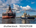 Small photo of Port of Amsterdam, Noord-Holland/Netherlands - October 22-10-16 - Big bulk carrier Chancy is underway to sea. The ship is receiving Svitzer tugboat towing assistance for safe sailing.