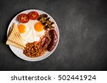 Small photo of English breakfast on a black chalkboard, copy space for text