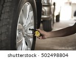 close up checking car tyre... | Shutterstock . vector #502498804