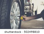 close up checking car tyre... | Shutterstock . vector #502498810