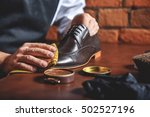 man shining shoes with a rag | Shutterstock . vector #502527196