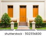 orange door   orange window on... | Shutterstock . vector #502556830
