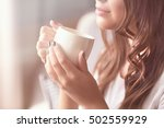 beautiful young woman with cup... | Shutterstock . vector #502559929