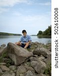 young teenage boy sitting by... | Shutterstock . vector #502610008