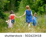 mother walks with daughters in... | Shutterstock . vector #502623418