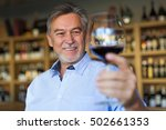 man with a glass of red wine | Shutterstock . vector #502661353