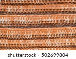 Small photo of Pattern of orange tone of stack roof tiles texture in overlapping layers ready to build and construction for background