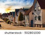 Street With White Houses At...