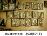 Small photo of Aleatory decorative letters made with a laser cutter.