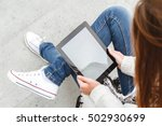girl sitting with a tablet in... | Shutterstock . vector #502930699
