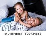 laughing little girl having fun ... | Shutterstock . vector #502934863