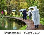 tourists wearing raincoat in... | Shutterstock . vector #502952110