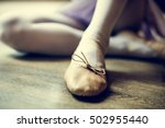 ballerina girl tie shoes concept | Shutterstock . vector #502955440
