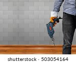builder or worker drilling with ... | Shutterstock . vector #503054164