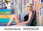 cute blond woman sitting next... | Shutterstock . vector #503056228