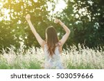 successful woman with arms up... | Shutterstock . vector #503059666