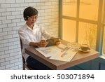 young businessmen sit across... | Shutterstock . vector #503071894