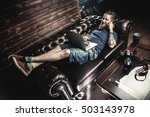 male head lying on the sofa in... | Shutterstock . vector #503143978