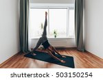 fit woman doing yoga on mat at... | Shutterstock . vector #503150254