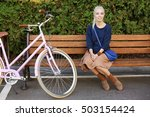Pretty Young Bicyclist Sitting...