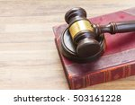 wooden law gavel on legal book
