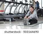 smiling woman doing stretching... | Shutterstock . vector #503164690