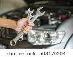 hand holding a wrench with a... | Shutterstock . vector #503170204