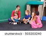 nursery woman reading book for... | Shutterstock . vector #503203240