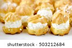 Small photo of Cream puff cakes with custard in a white box