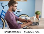 man working on laptop at home | Shutterstock . vector #503228728
