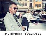 handsome man drinks coffee in... | Shutterstock . vector #503257618