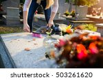 Small photo of Woman cleans a grave. November 1 All Saints' Day