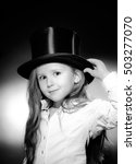Small photo of Cute little girl posing in gibus, old-style opera hat, vintage photo