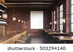 Stock photo bar interior with stools tables and large vertical poster on dark brick wall concept of pub 503294140
