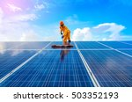 a man working on solar panels. | Shutterstock . vector #503352193